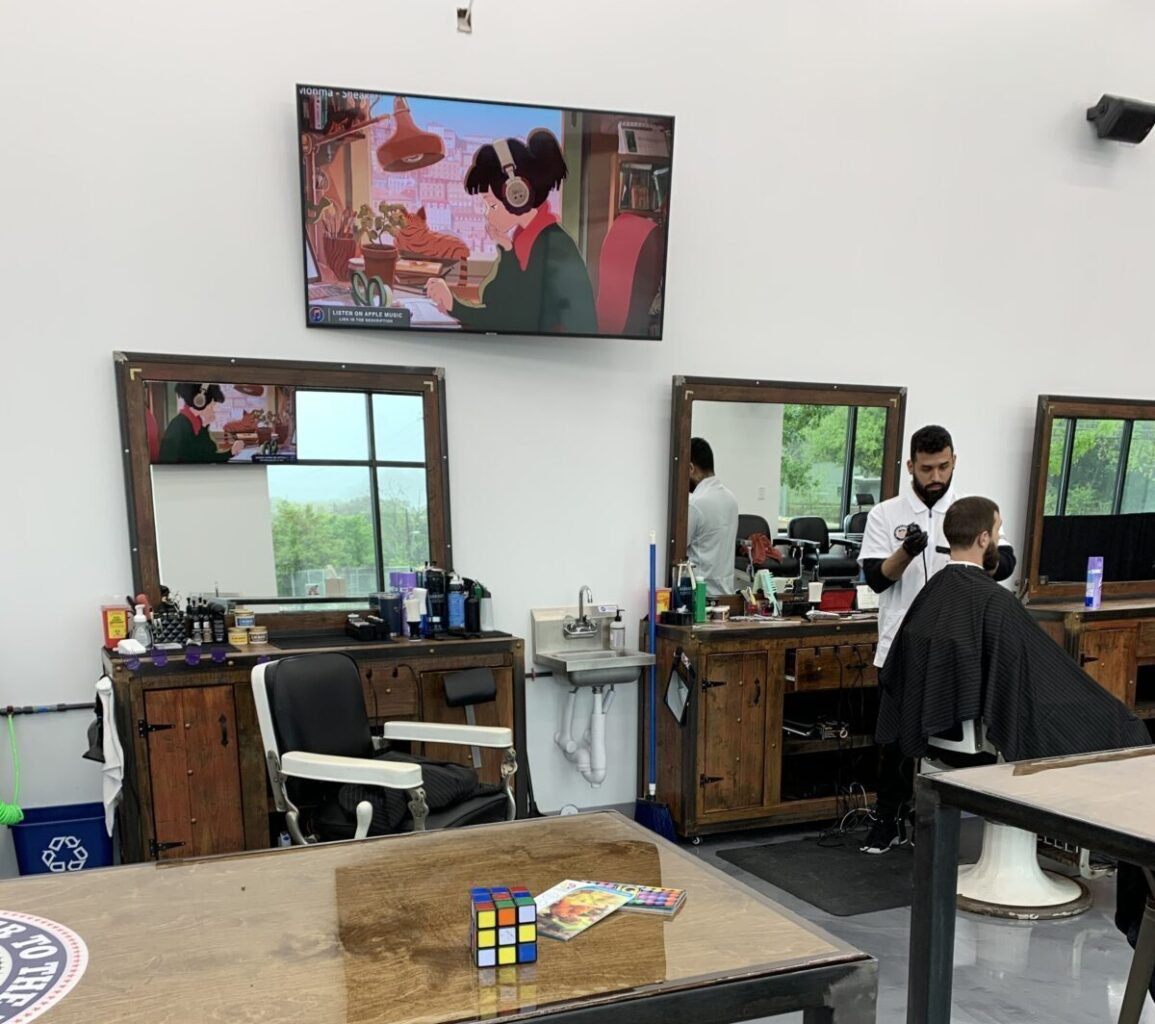 multiple mounted TVs and speakers installed throughout salon