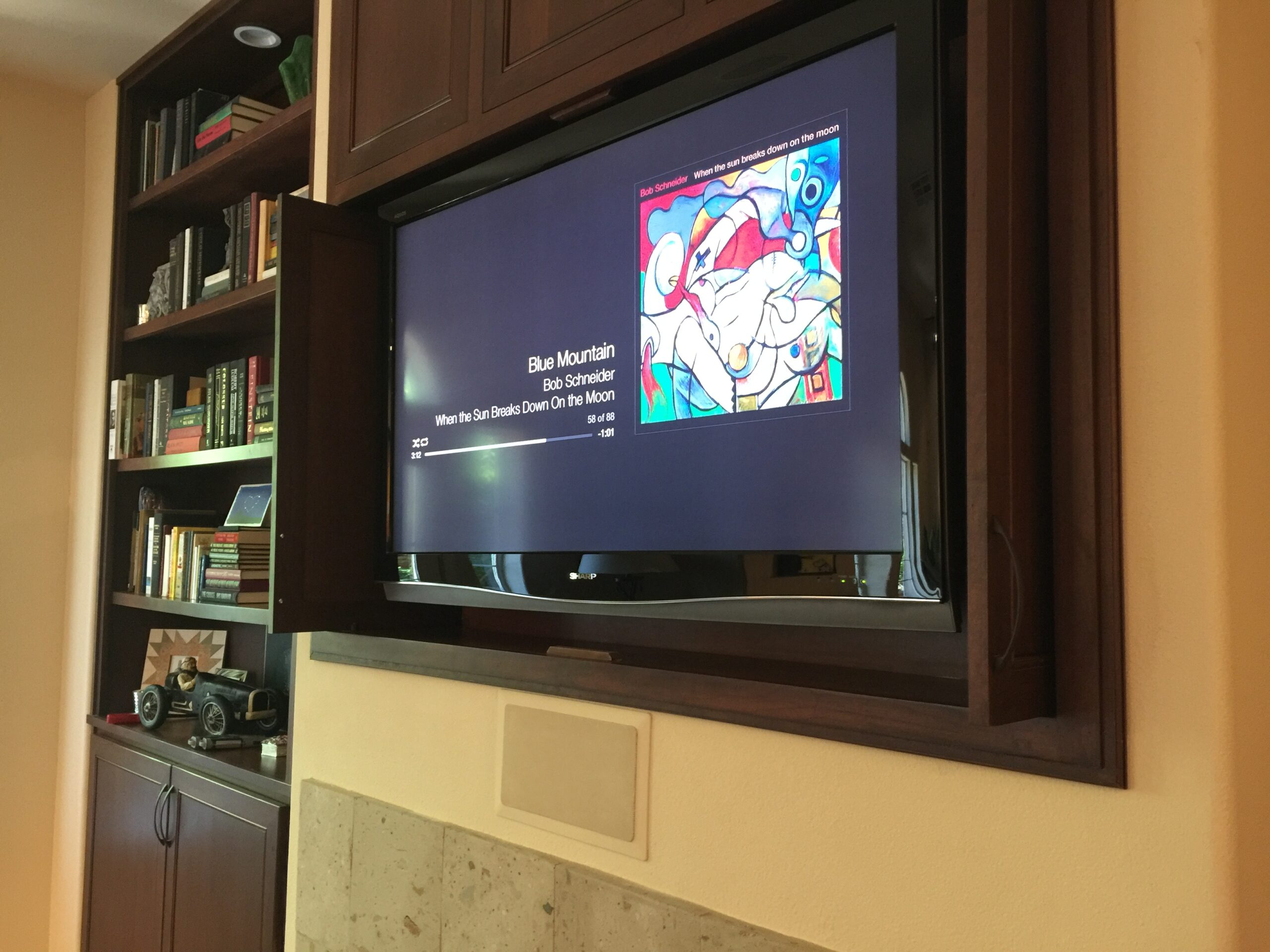 Fireplace mounted TV and sound system