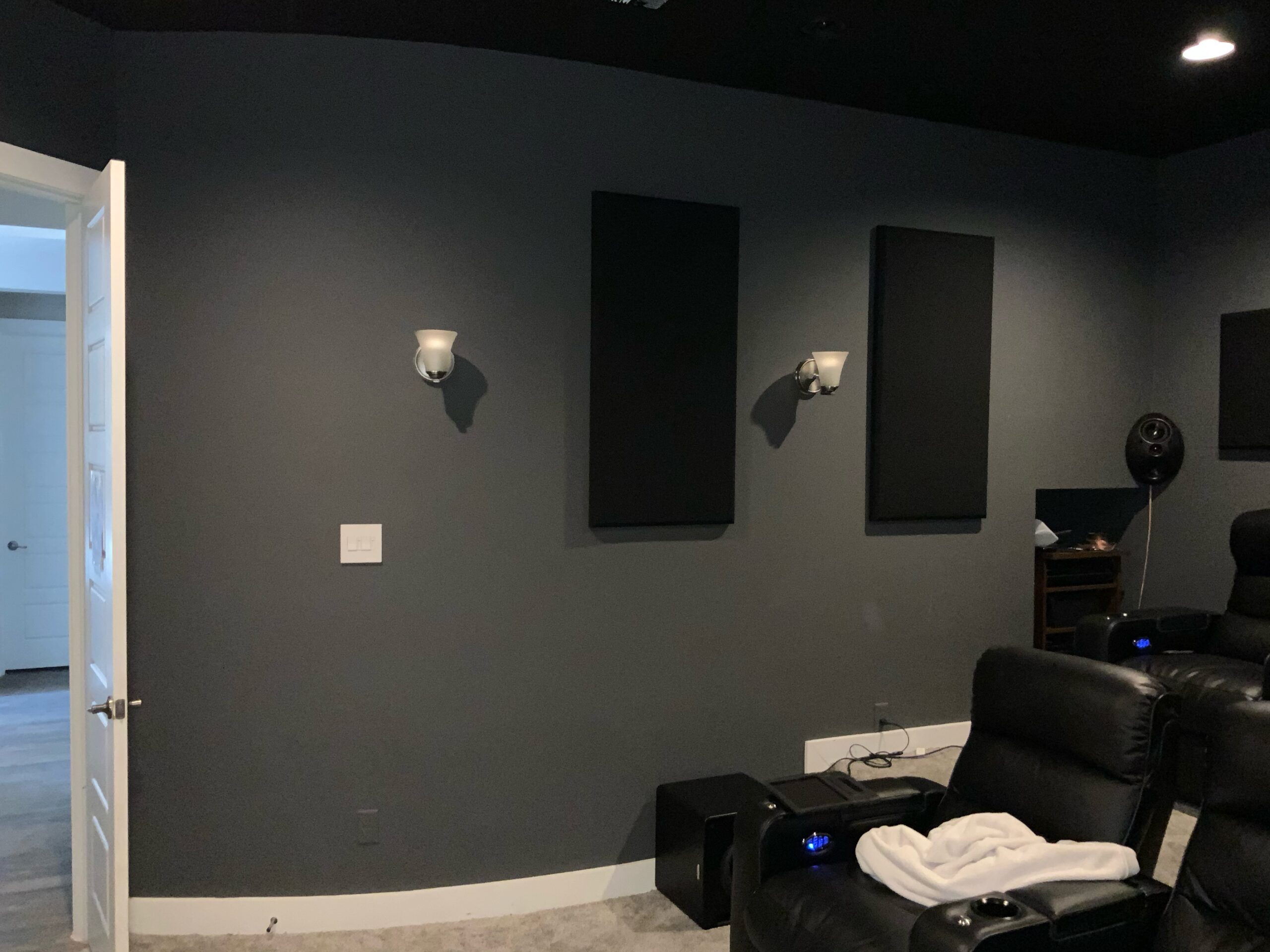 Home theater sound system with acoustic panels