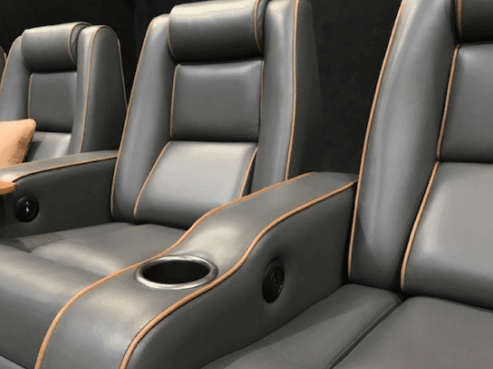 Dedicated home theater custom seating leather with orange accents