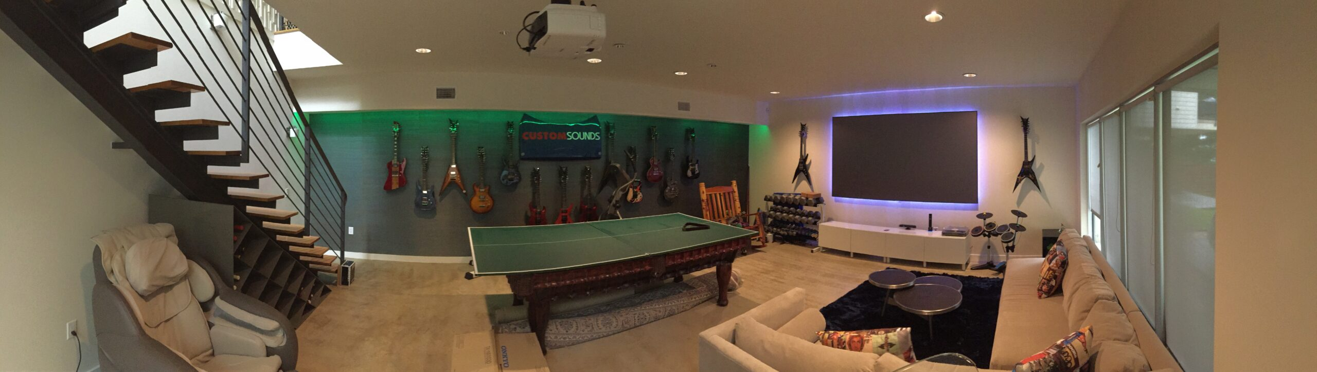 Austin Texas game room integrated with short throw laser projection, full surround sound and custom lighting