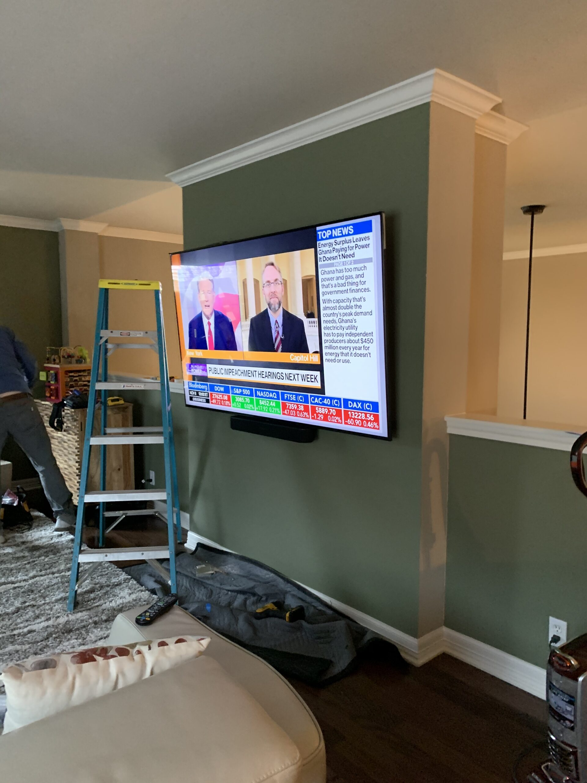 Large flat screen smart controlled TV mounted on wall