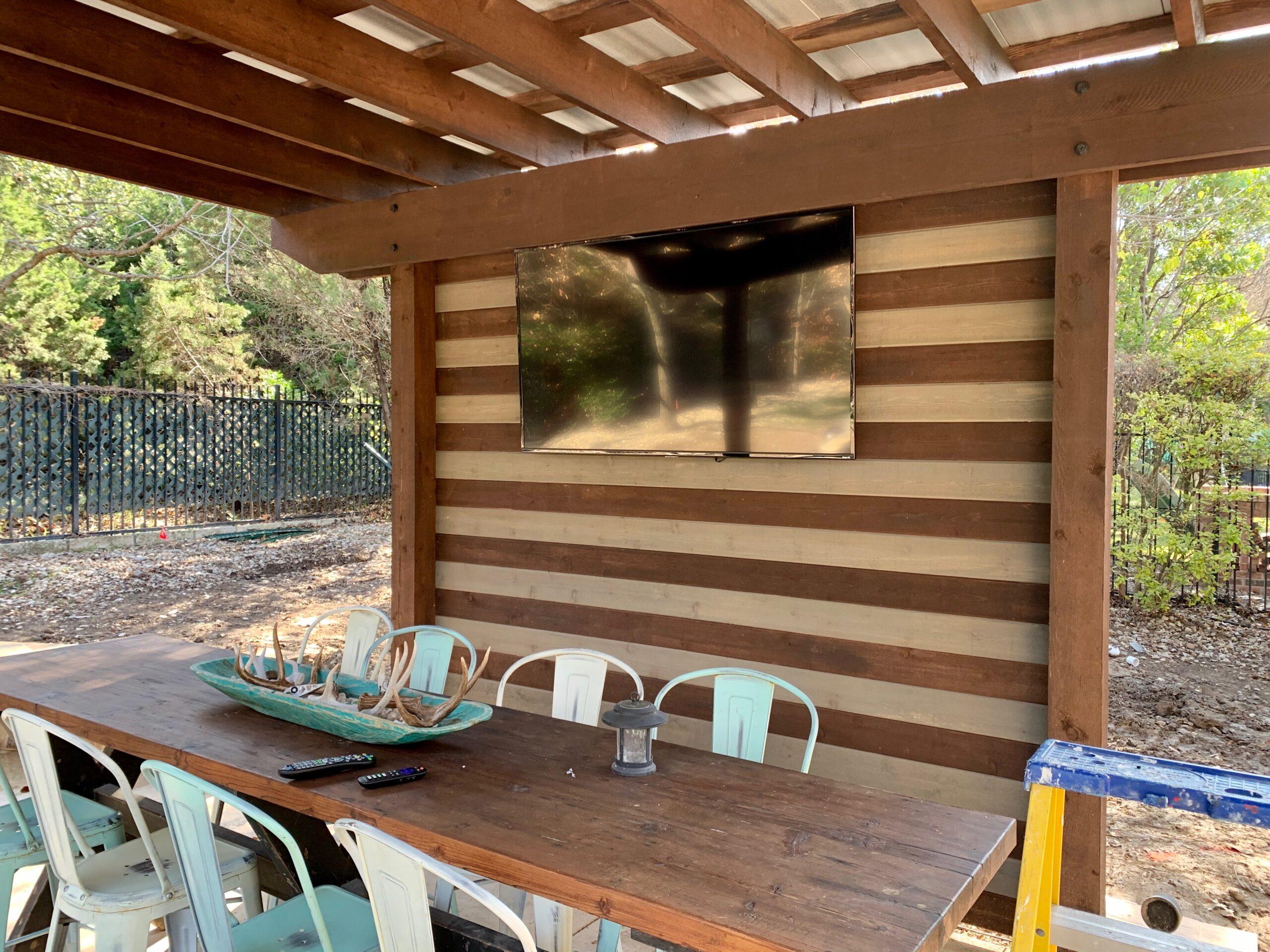 Outdoor Samsung framed TV mounted