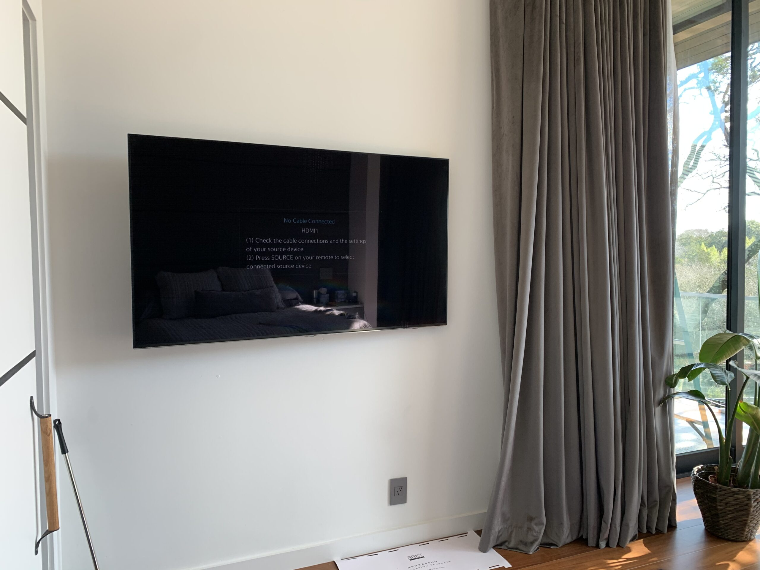 Luxury condo with flat screen mounted TV and home surround sound system