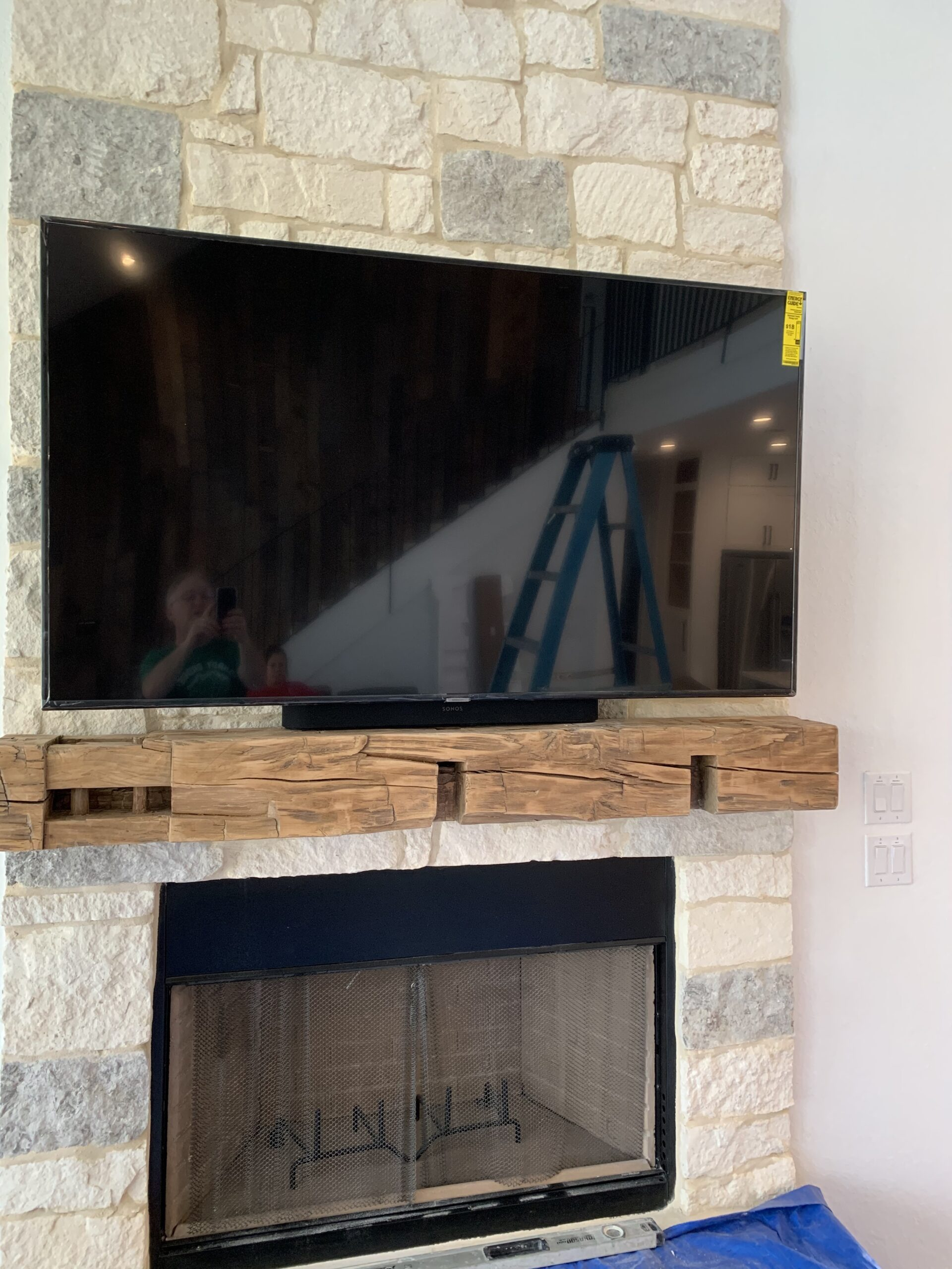 fireplace mounted TV install and home speakers