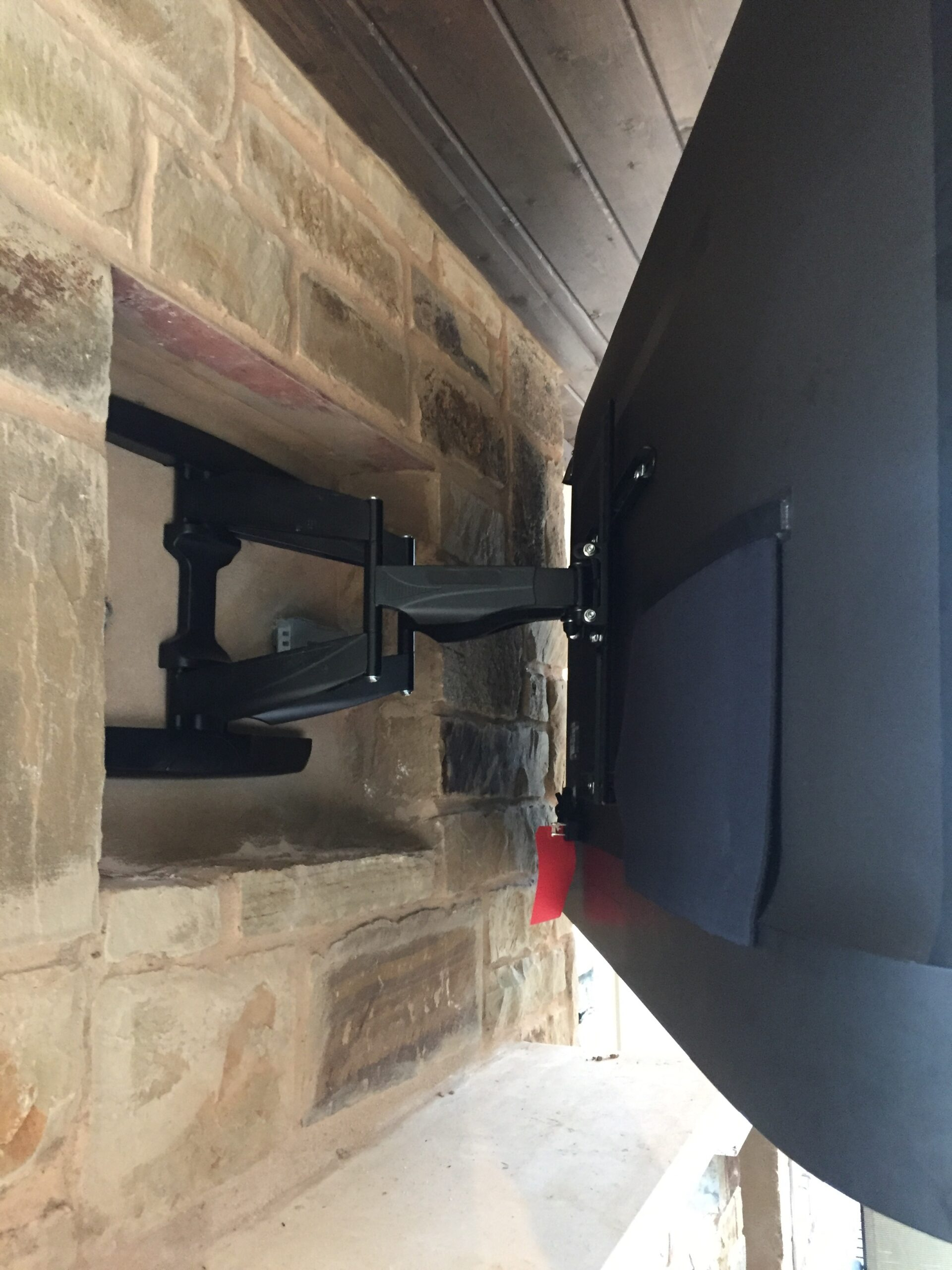 Outdoor TV installed into brick siding