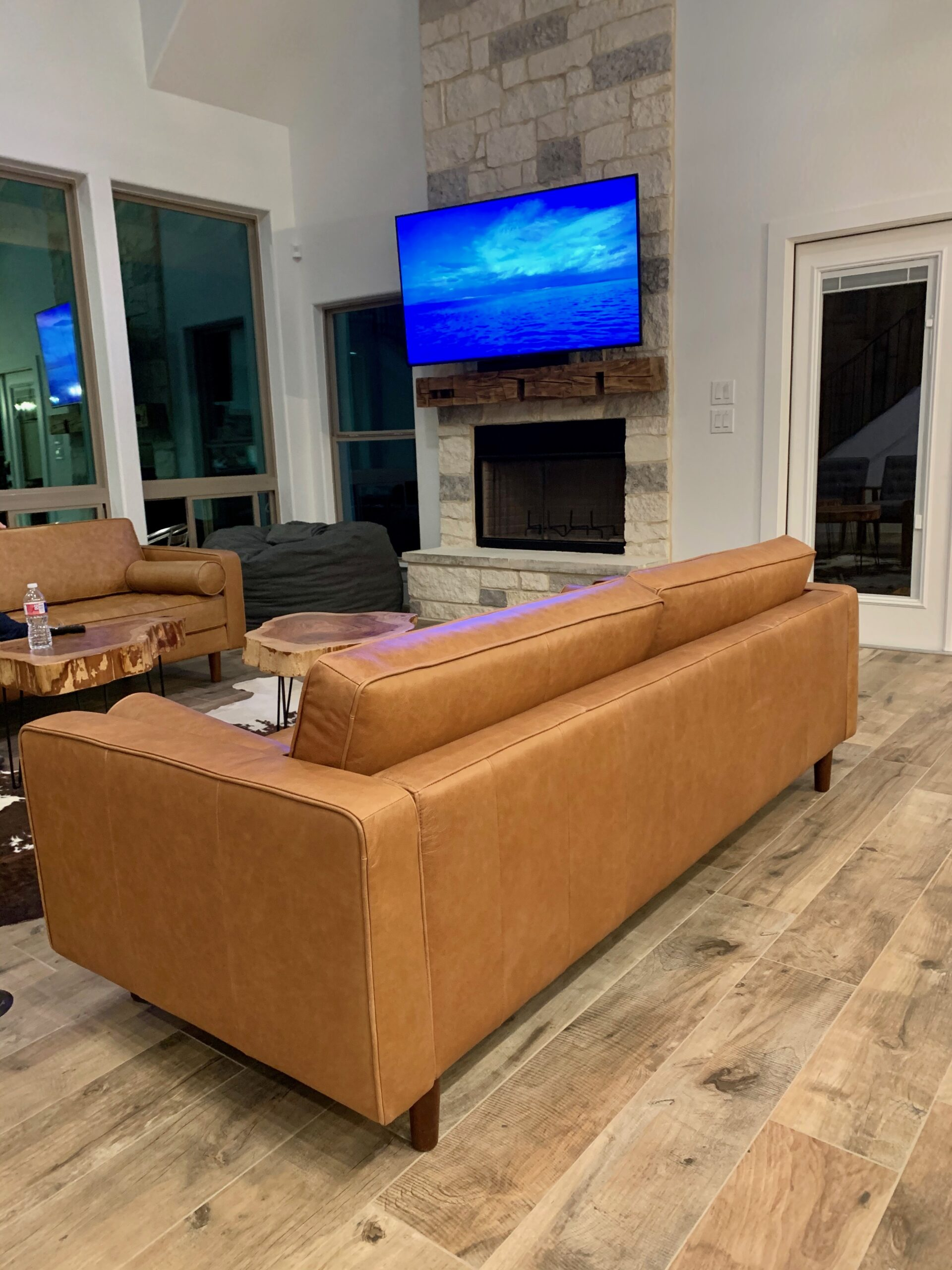 Smart integrated media room with TV installed above fireplace