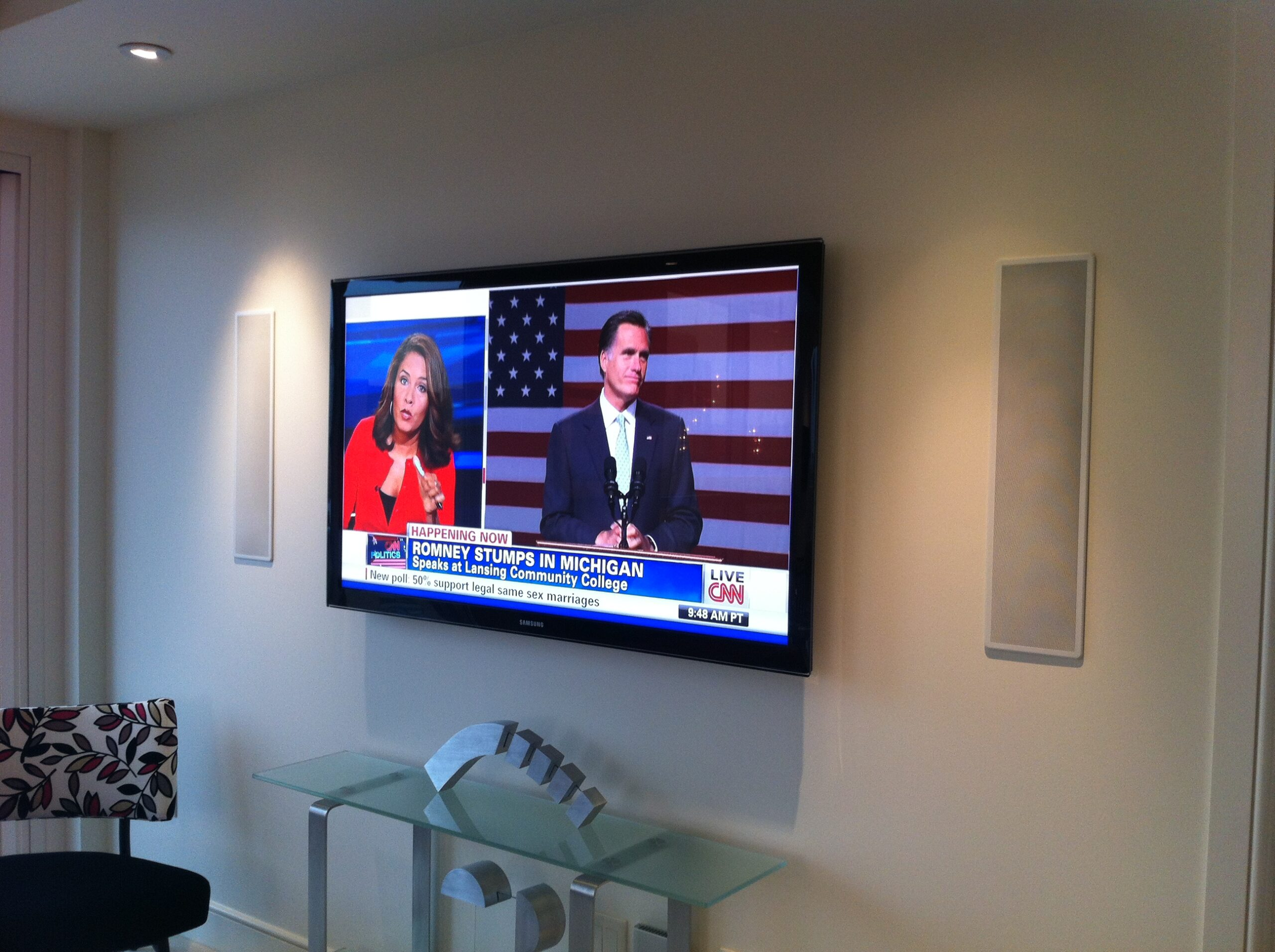 Framed smart TV and integrated full home sound system