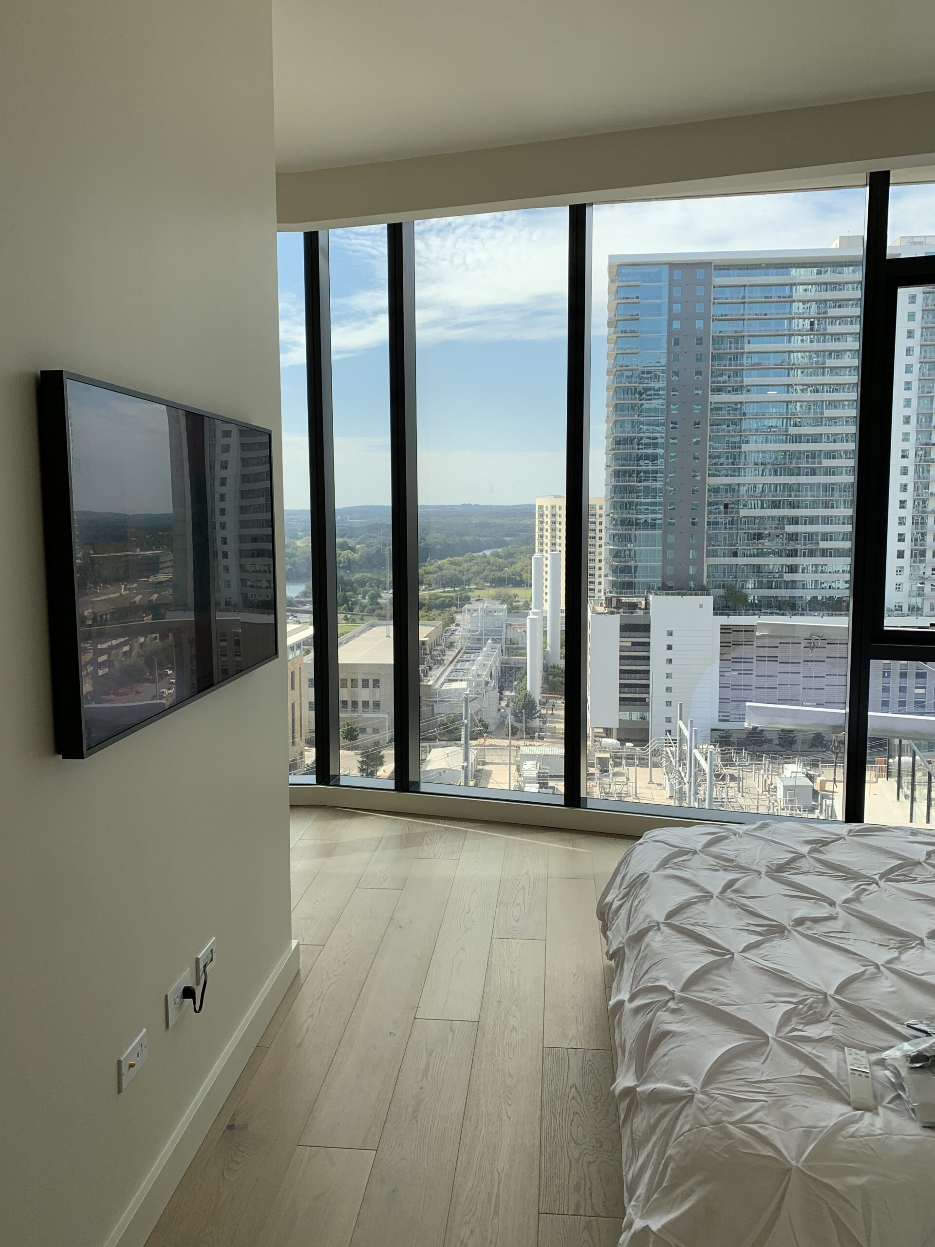 Luxury condo integrated with smart Samsung framed TV, surround sound and a simple smart system