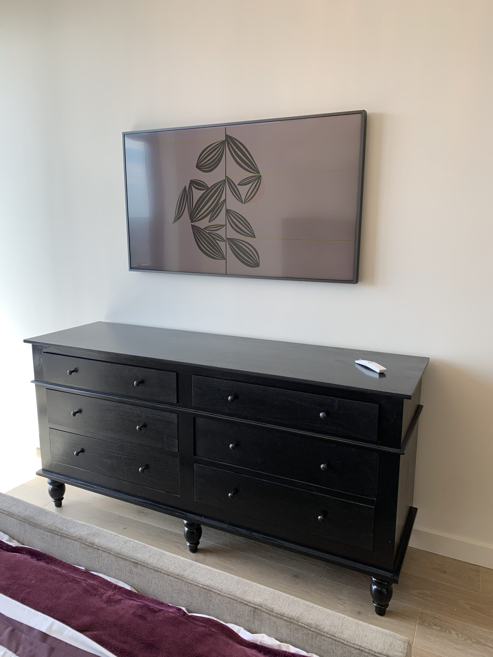 Samsung framed TV installed with art images in home media room
