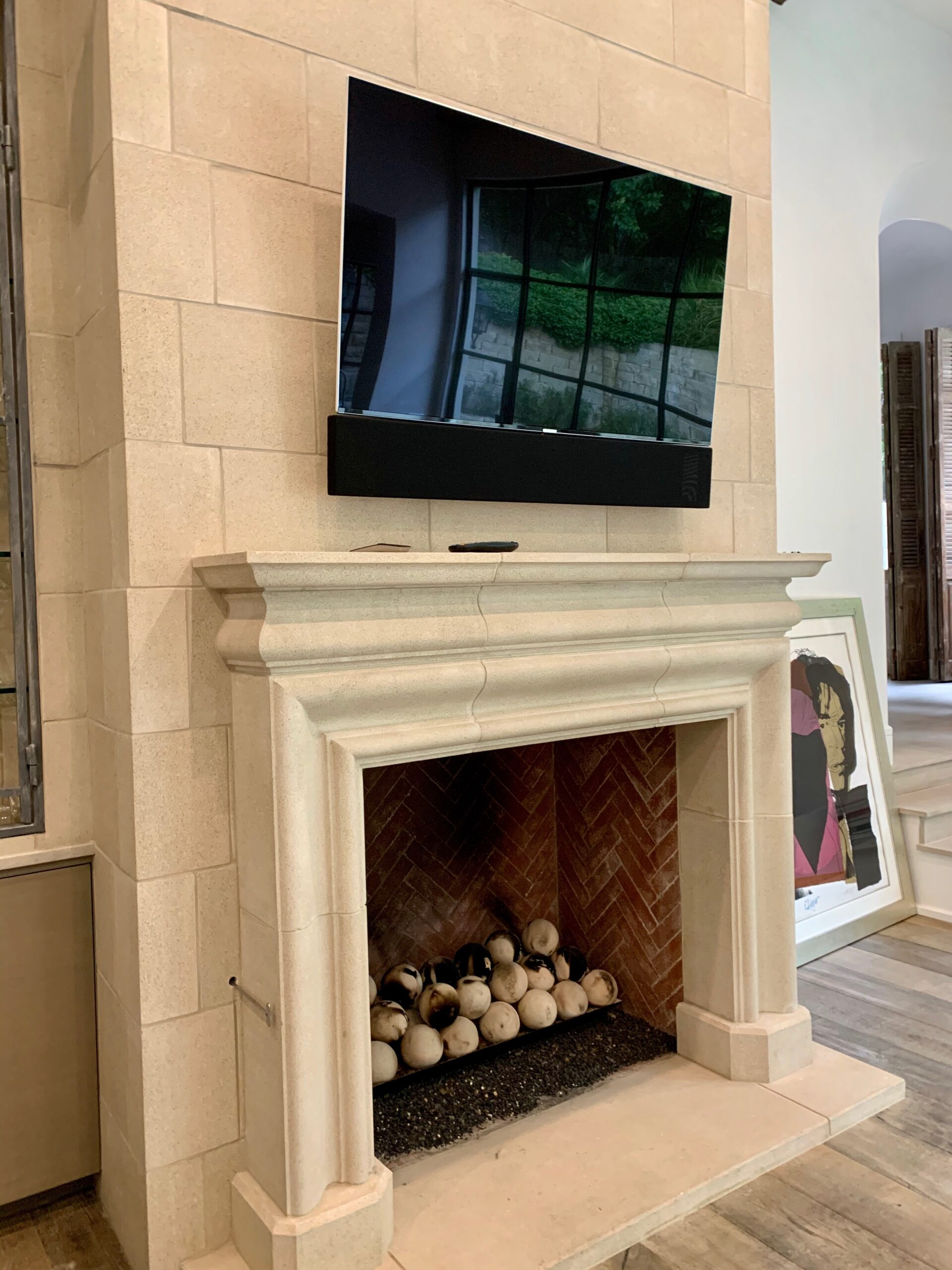 Thin flat screen TV products installed above fireplace