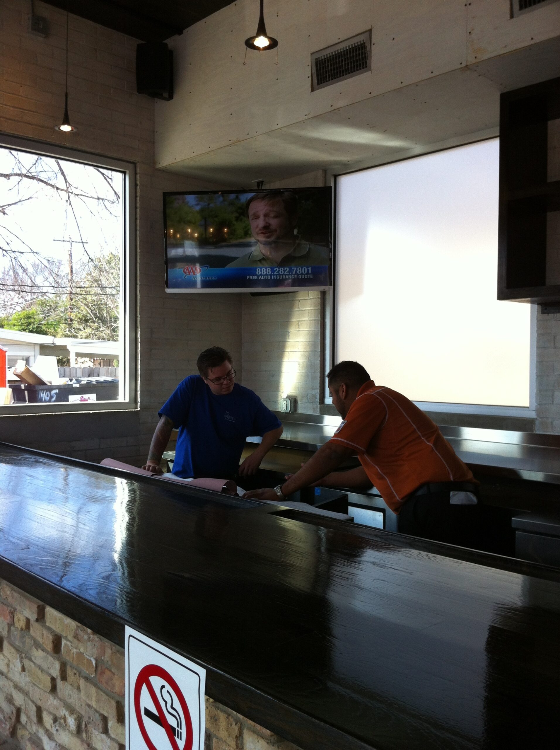 Retail Fast food with smart control system, surround sound speakers and smart mounted TVs