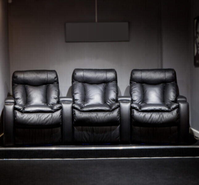 Leather armchairs in home cinema dedicated home theater