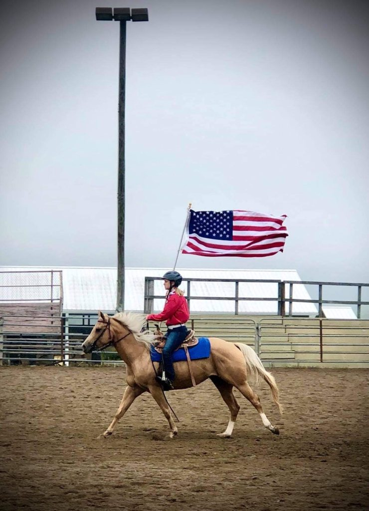 Horse show rider with American Flag