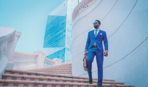 Man in blue business suit standing on steps