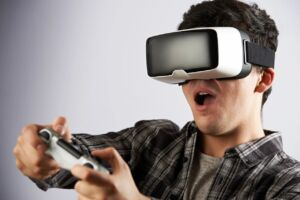 Man playing virtual reality video game with headset and controller