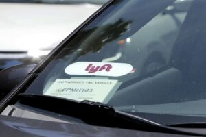 Close up of a Lyft ride-share car as it waits at a stoplight in Sacramento, CA.