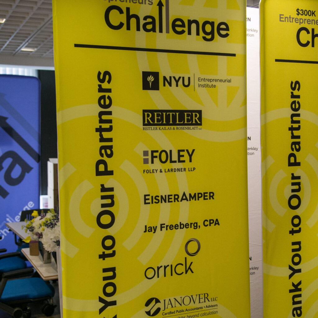 Yellow NYU Entrepreneurs Challenge banner displaying the logo of partners
