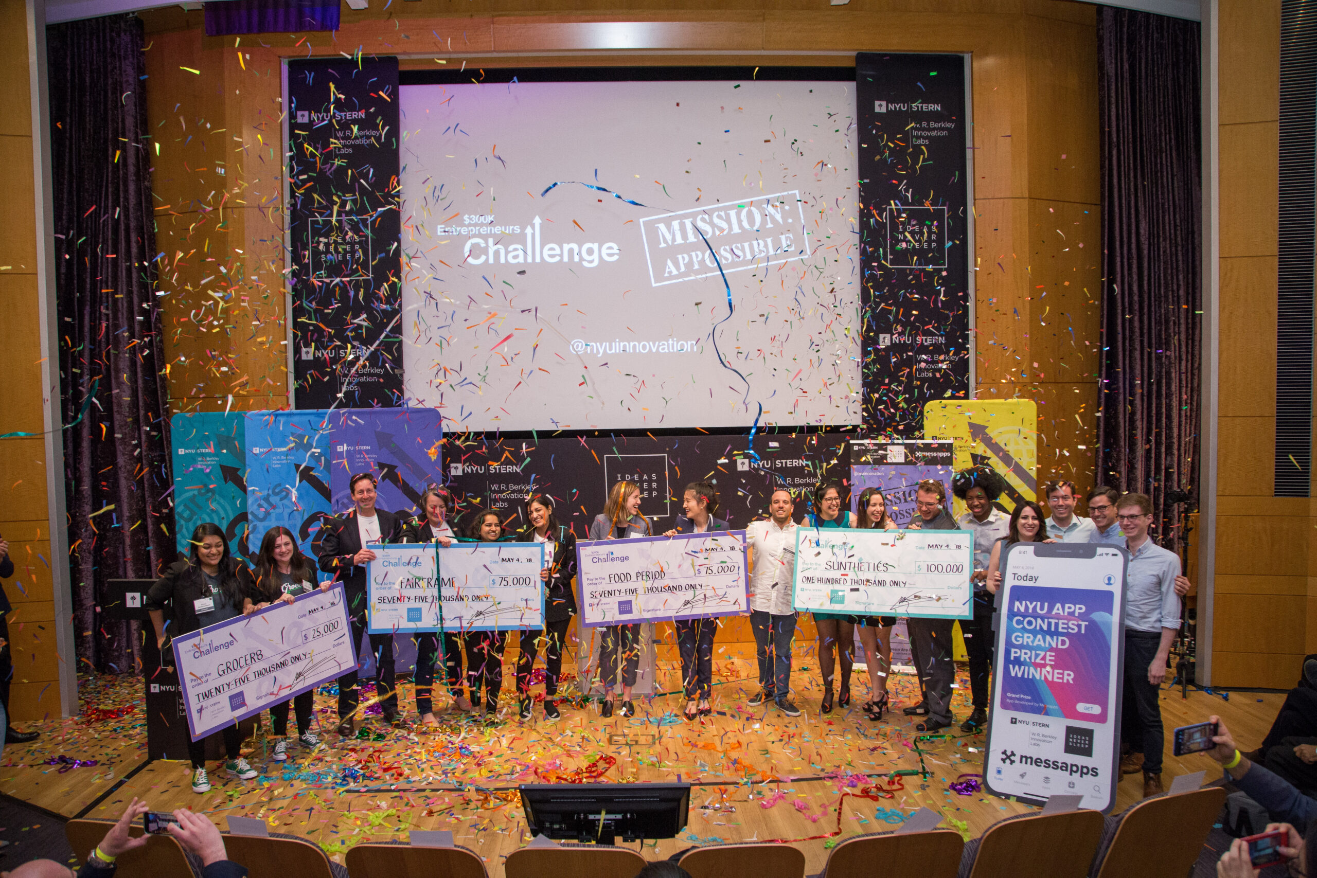 Entrepreneurs Challenge Winners on the stage with confetti and large checks.