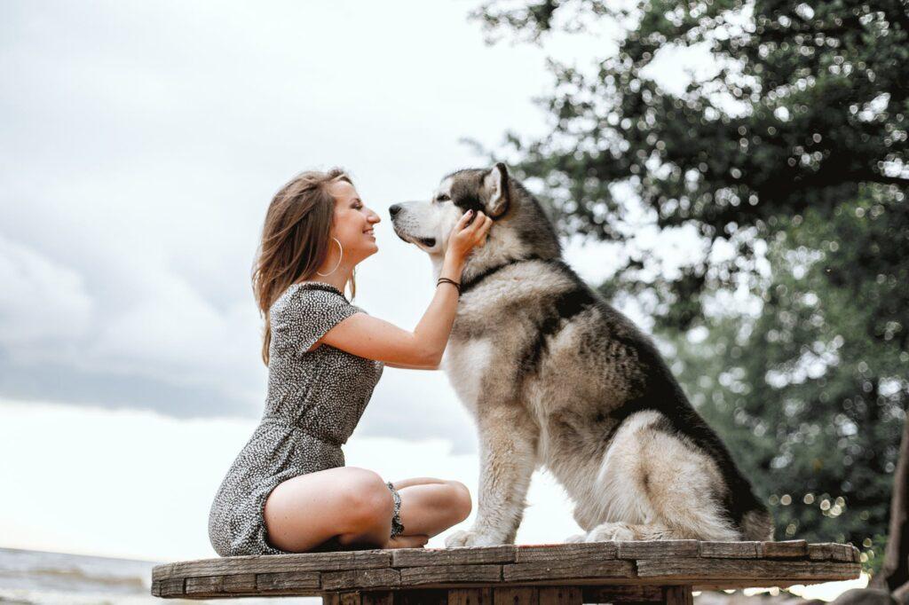 woman and malamute