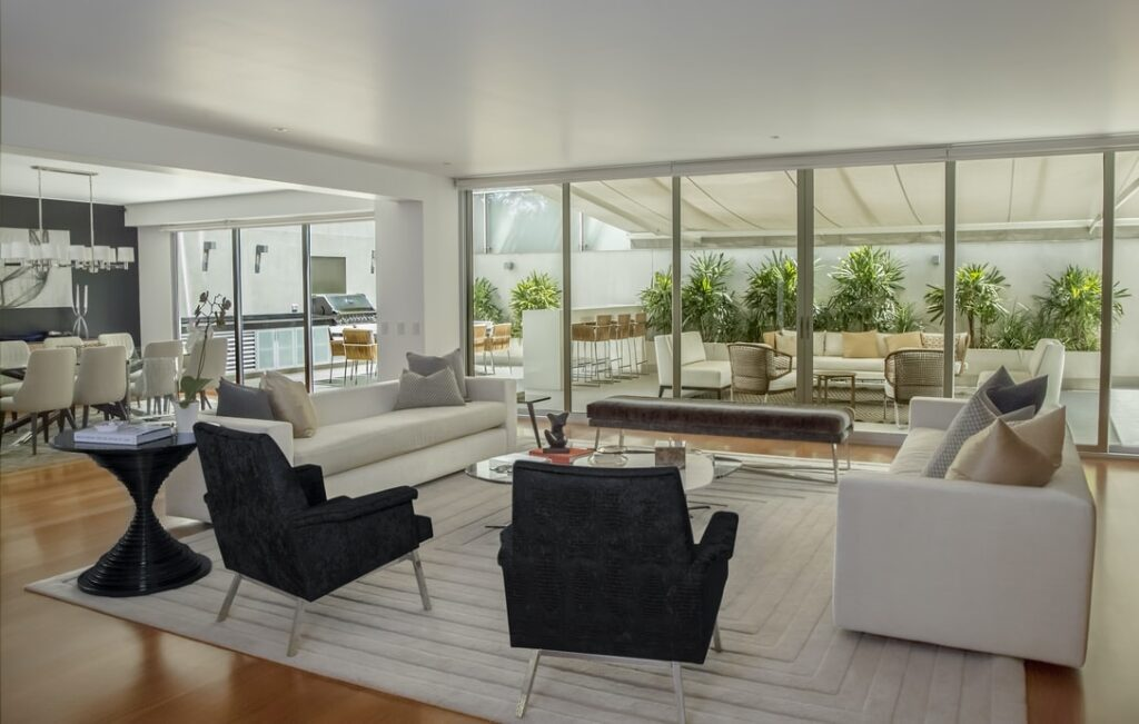 modern living room with backyard and kitchen