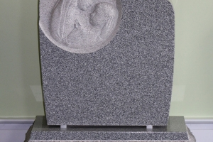 sculpted mother and child - religious - blue gray - grave stone