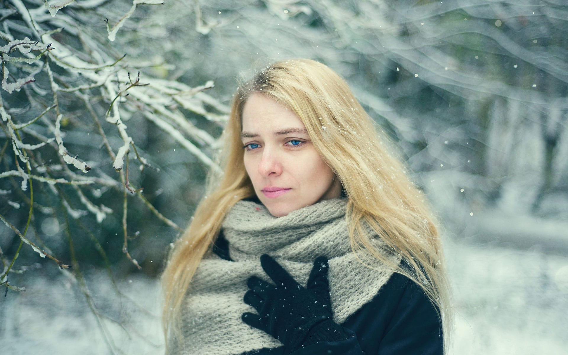 stressed woman with scarf in snow