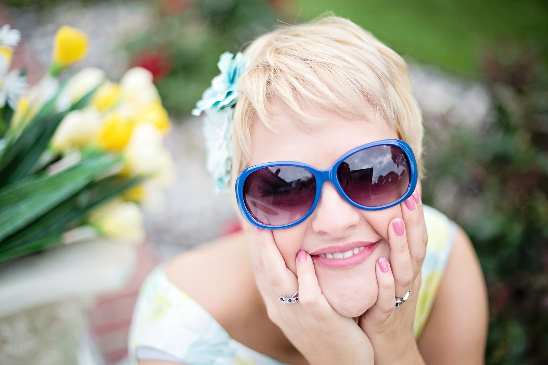 happy woman wearing blue sunglasses