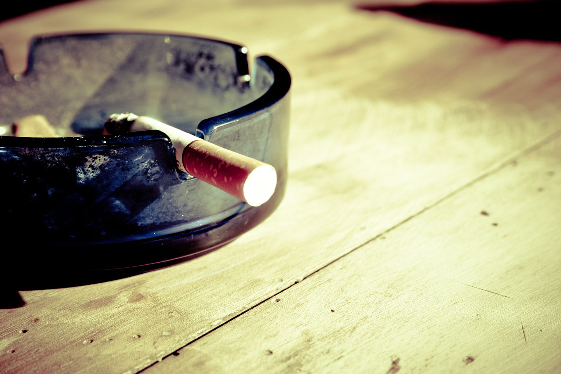 burning cigarette in ashtray