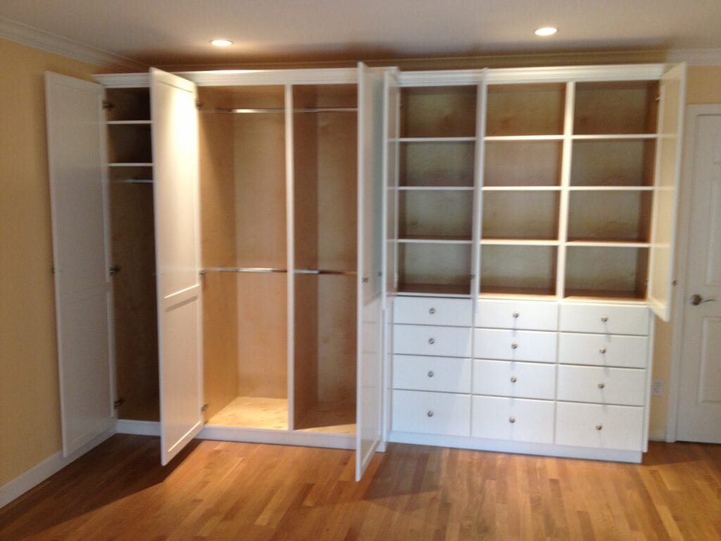 Open white closet and cabinets