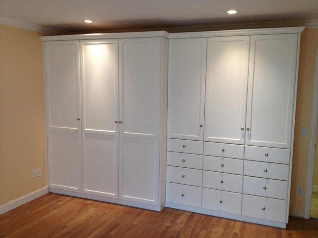 Closed white closet and cabinets