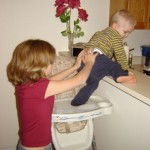 child safety picture of child climbing on counter