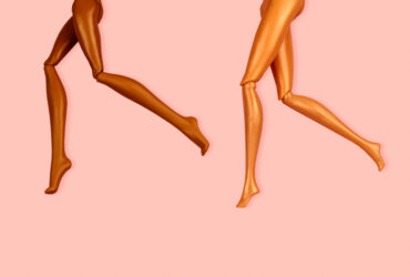 legs of plastic dolls with different skin color on pink background, hair removal and skin care concept