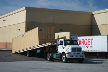 truck delivering storage container to Target