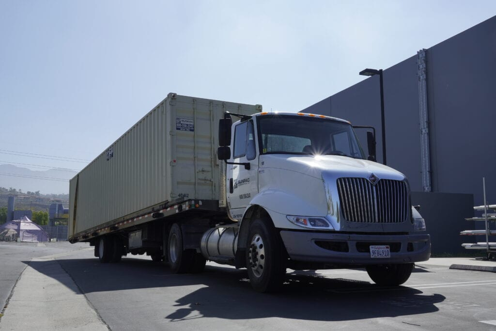 Truck delivering storage container