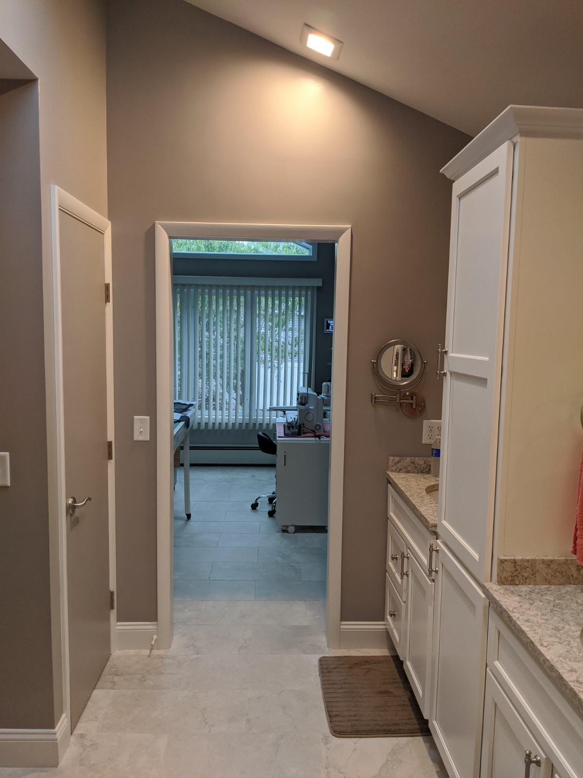 This picture shows the flow of the bathroom is now open because we removed the back to back vanities and placed them on the single wall