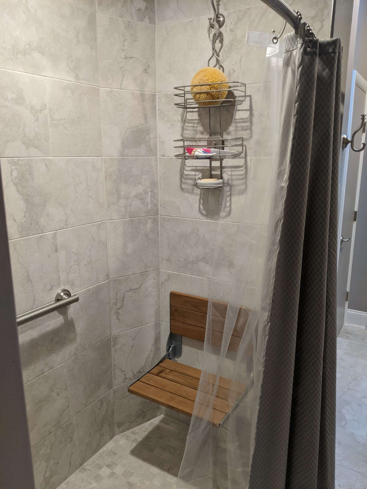 Another view of the tile shower with the pull down seat