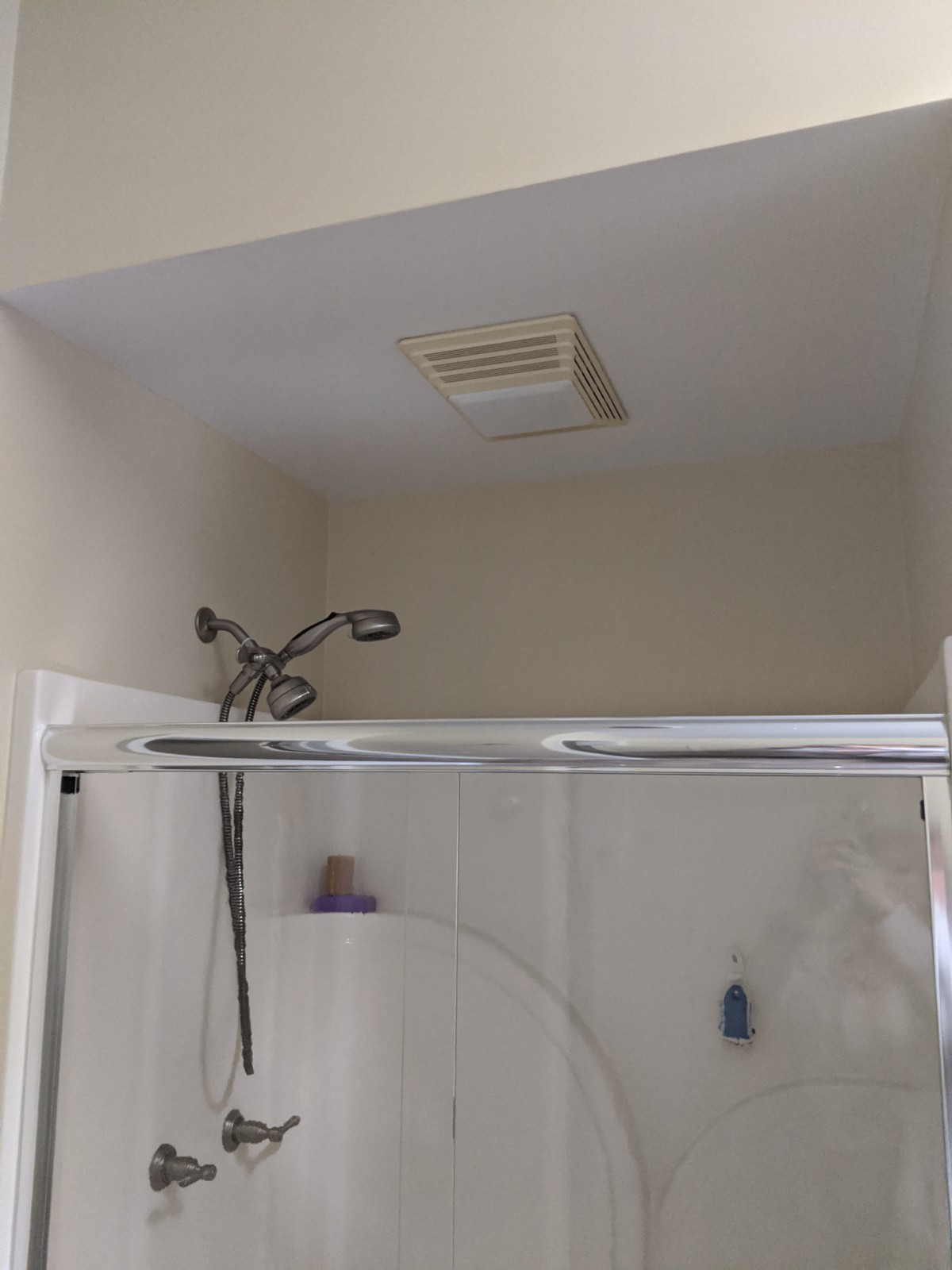 This is a before picture of a shower with just a surround