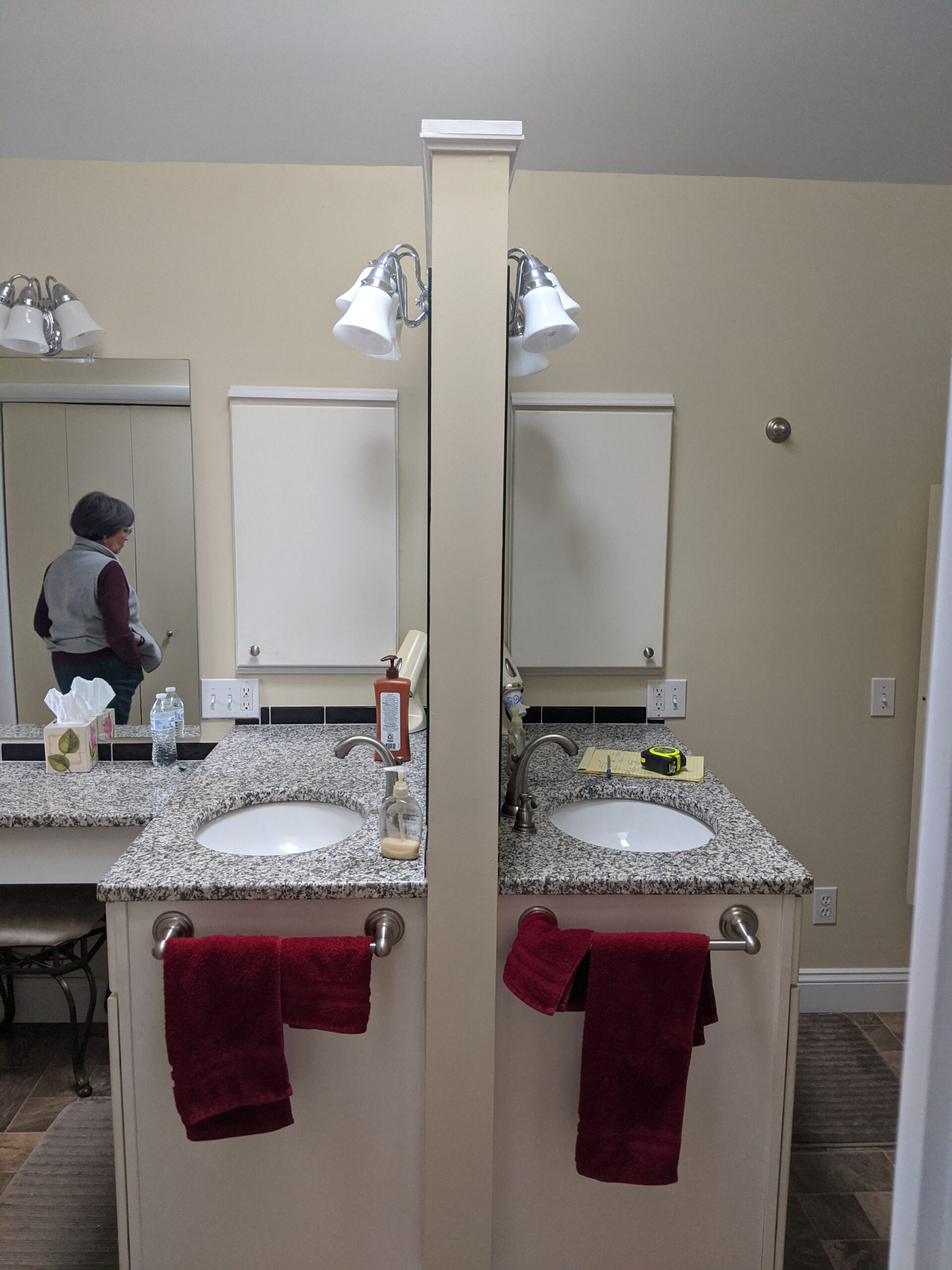 This picture is showing the vanities back to back in the middle of the room, it blocked the flow of traffic in the bathroom