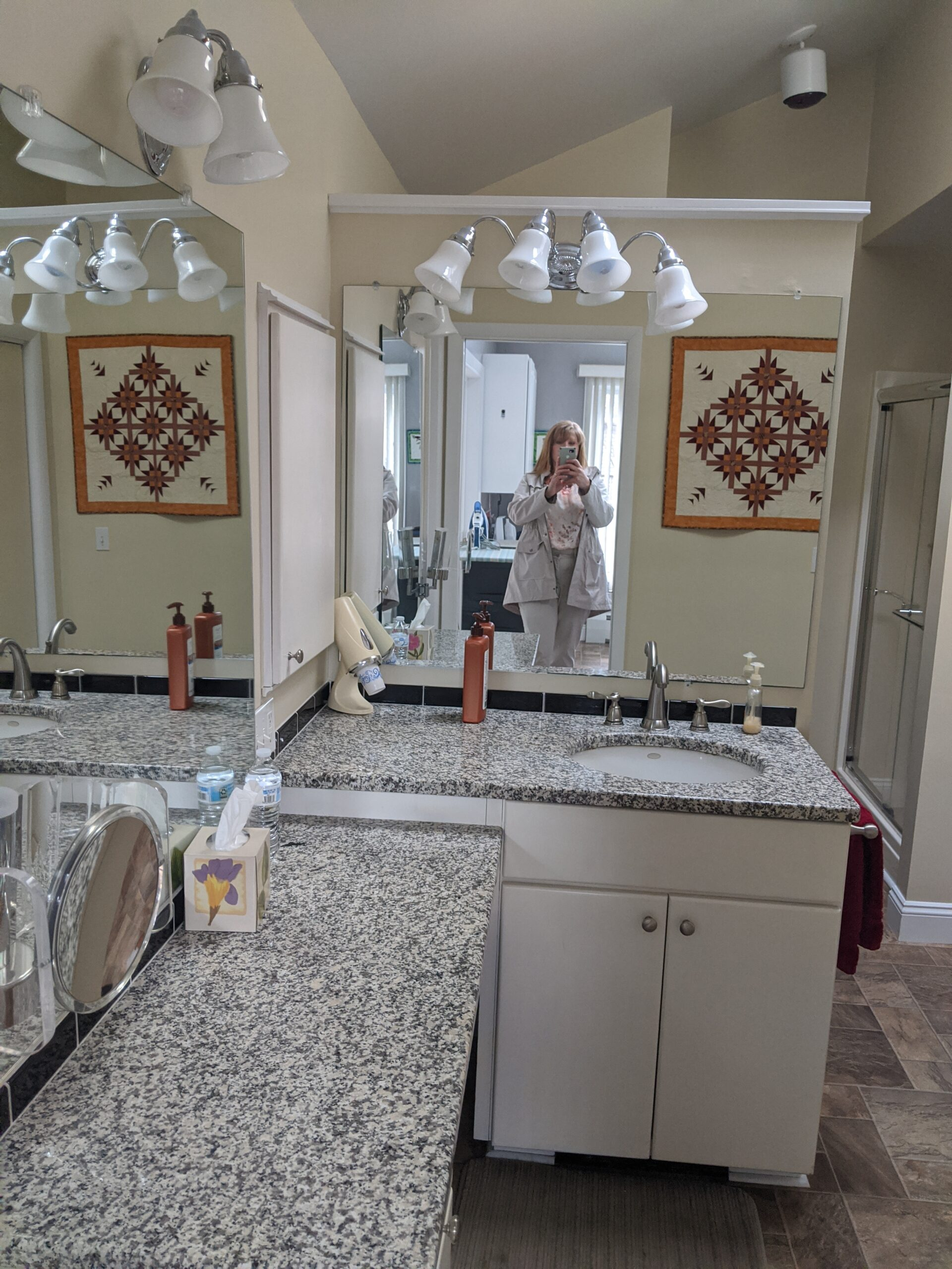 This picture is another angle showing the back to back vanities and how they stuck into the middle of the room.  The fall wall blocked natural light too