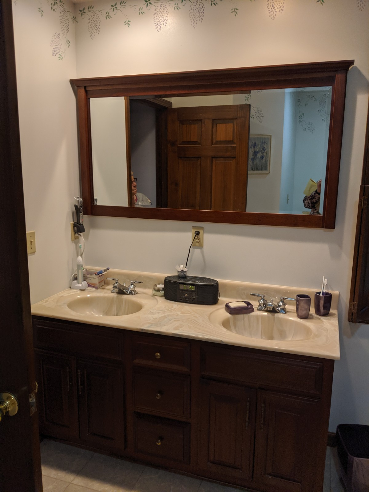 Outdated cultured marble double vanity top with outdated fixtures