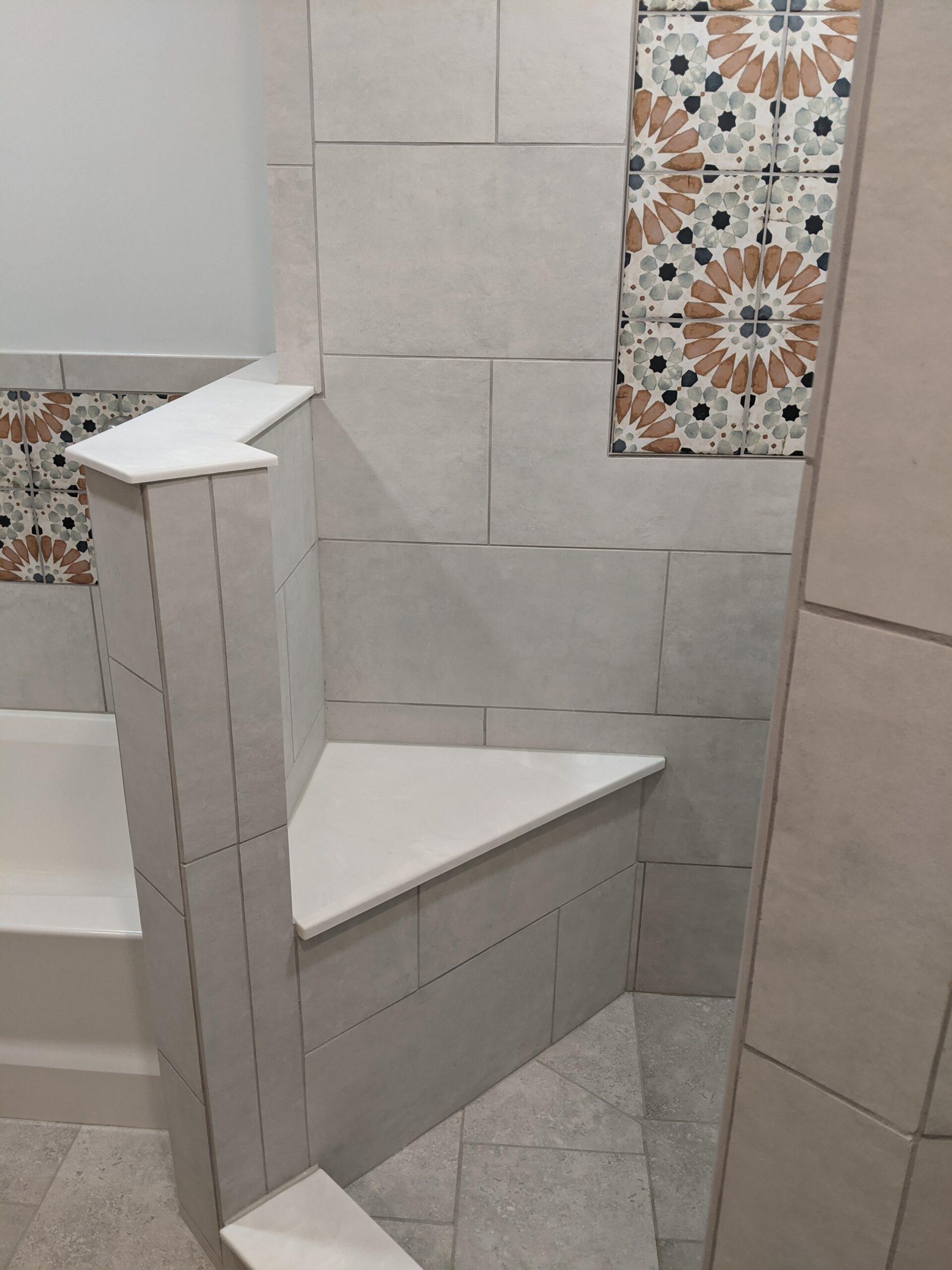 Custom tiled shower with built in custom seat