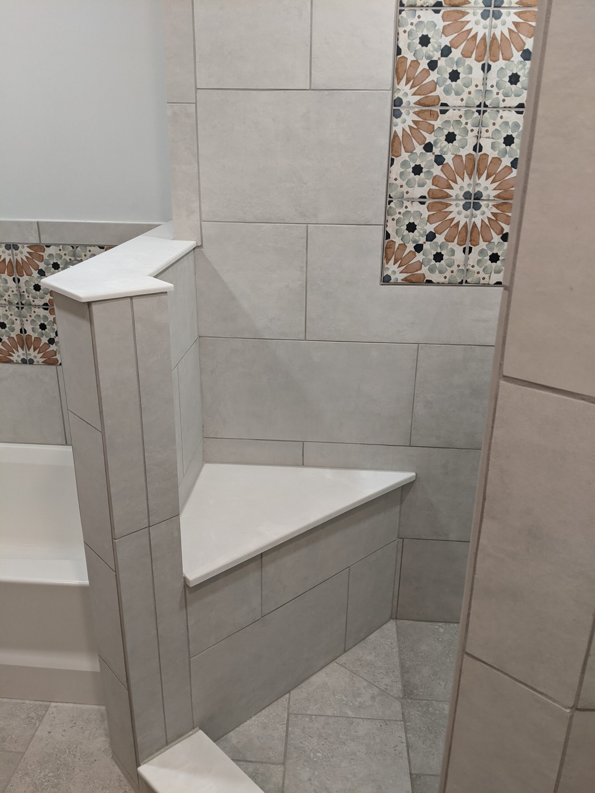 Custom tiled shower with built in custom seat