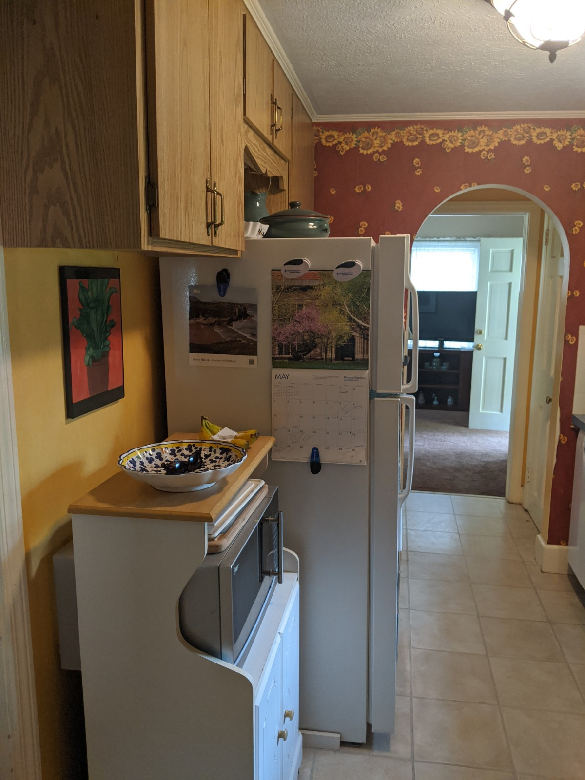 Showing before kitchen with arch and old cabinets