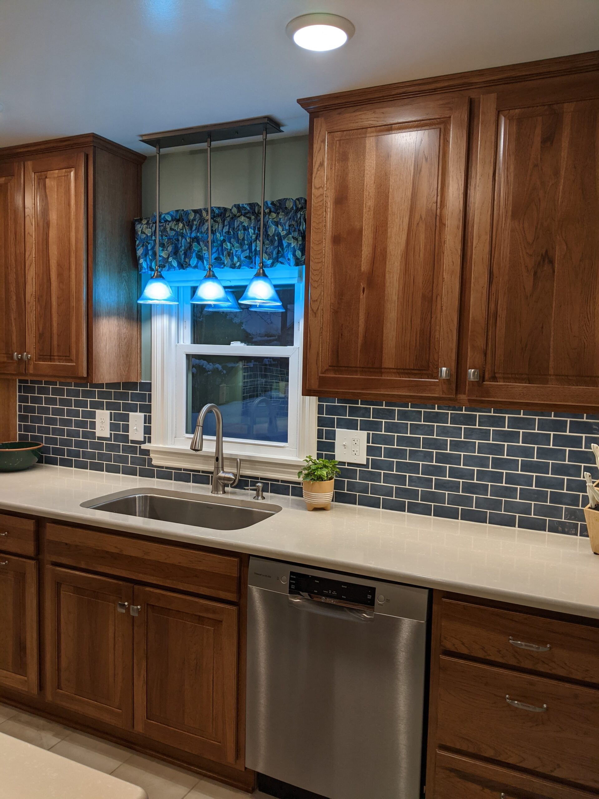 Another view of the sink area showcasing the tile