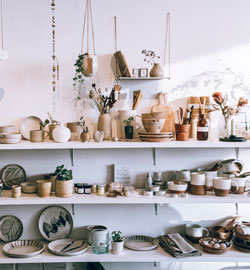 assorted-ceramics-on-wooden-shelves