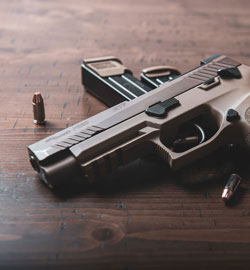 black-and-silver-semi-automatic-pistol-on-brown-wooden-table