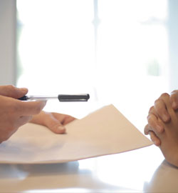 crop-businessman-giving-contract-to-woman-to-sign
