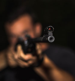 photo-of-man-holding-rifle