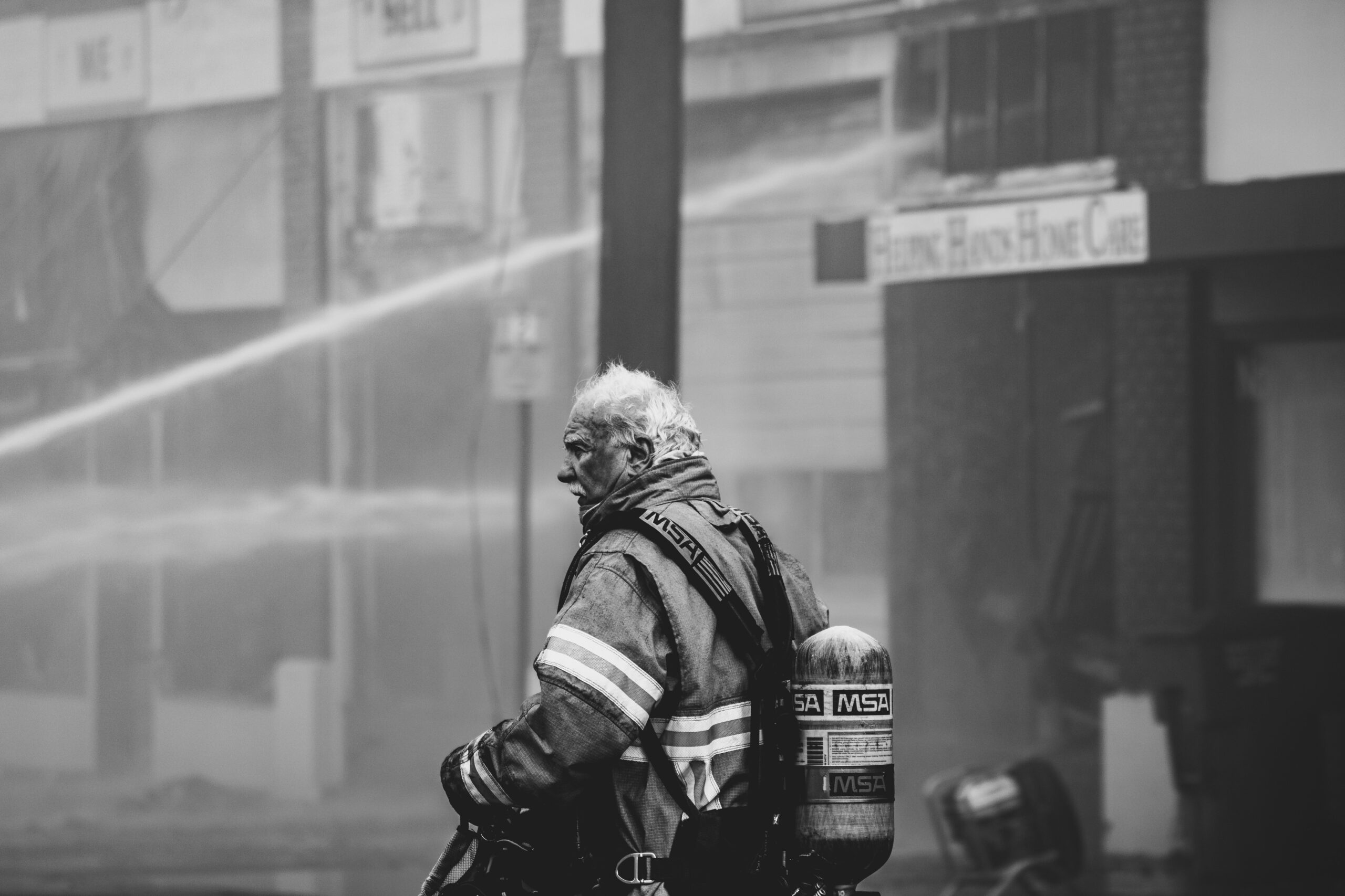 grayscale-photo-of-firefighter-3013675